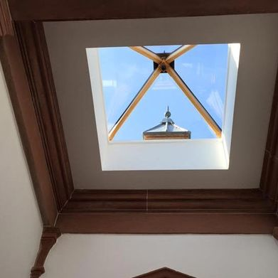 A ceiling decorated around a skylight